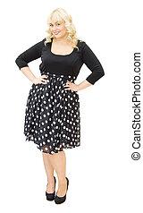 Chic in polka dots dress - beautiful woman smiling
