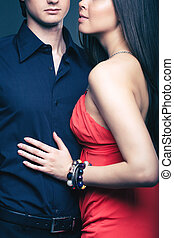 Chic lovers - Vertical shot of a luxurious couple posing...