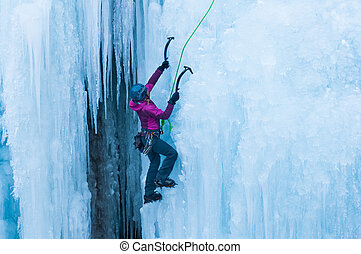chic with picks - athletic woman in pink coat climbing ice ...