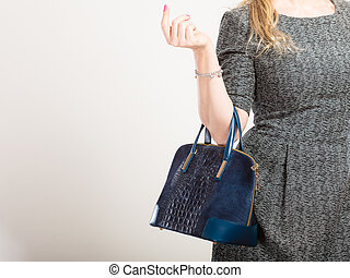 Chic woman with handbag.