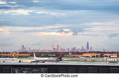 Chicago airport and skyline of the downtown.