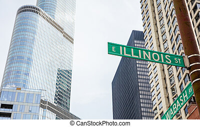 Chicago city skyscrapers, Illinois street and Wabash avenue crossing green signs