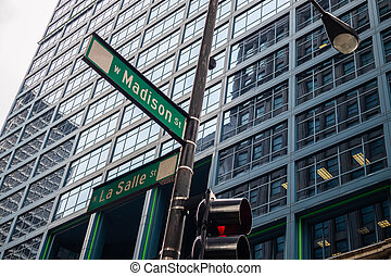 Chicago city skyscrapers, Madison and La Salle streets crossing green signs