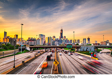 Chicago, IL, USA downtown cityscape highways at dawn.