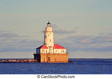 Chicago Light House in Lake Michigan with cloud and blue sky at sunset.