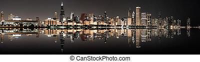 Panoramic image of the Chicago Skyline at night.
