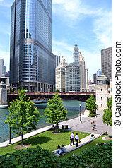 People enjoying Chicago's riverwalk during the summertime