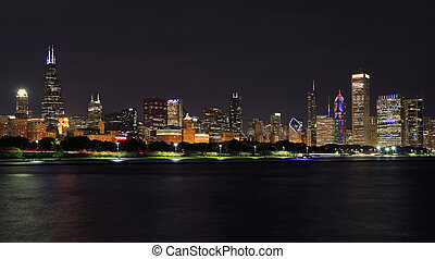 Chicago skyline at night with Lake Michigan on the foreground