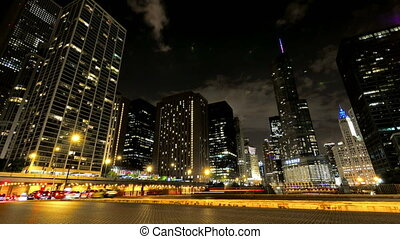 Chicago Skyscrapers at Night with Cars Crossing the City