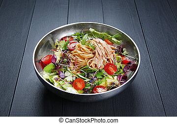 Chichen salad Pasta with spaghetti, tomato and herbs in bowl