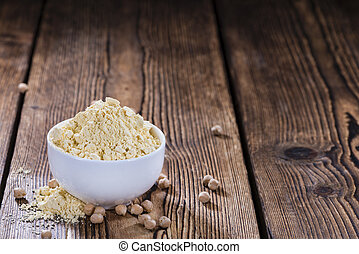 Portion of Chick Pea flour on vintage wooden background