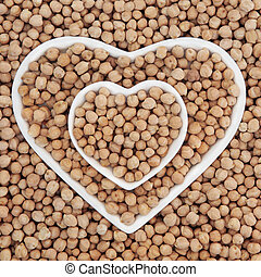Chick Peas - Chick pea health food in heart shaped bowls and...