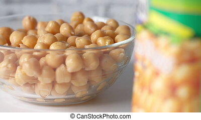 chick peas in a bowl on white background .