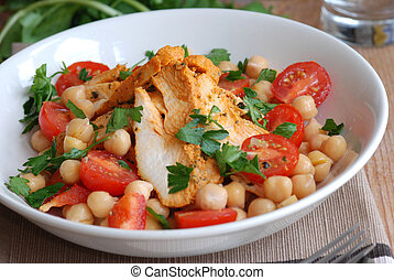 Freshly made Spanish chicken and chickpea salad in a bowl