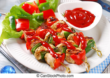 chicken and vegetable grilled skewers with ketchup