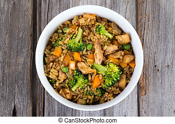 chicken and vegetable rice bowl on a old wooden grey wood background