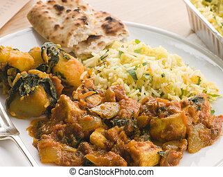 Chicken Bhoona, Sag Aloo, Pilau Rice And Naan Bread