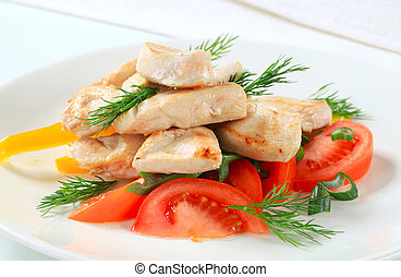 Chicken breast pieces with vegetables