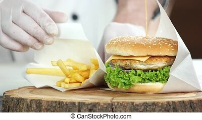 Chicken burger and fries. Junk food close up.