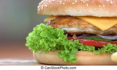 Chicken burger and fries macro. Bun, fresh vegetables and...