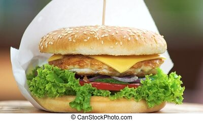 Chicken burger close up. Fast food sandwich.