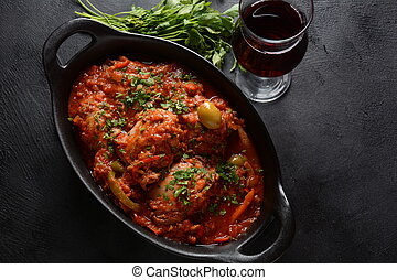 Chicken cacciatore with bell peppers, tomatoes, black olives. Italian food