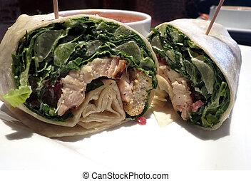 Chicken Caesar Wrap - Closeup of a chicken Caesar wrap, cut...
