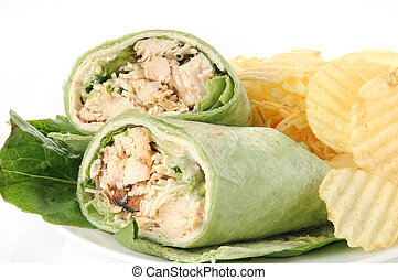 Closeup of a chicken ceasar wrap sandwich with chips