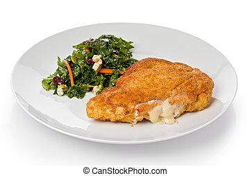 Chicken Cordon Bleu - Chicken cordon bleu with a small green...
