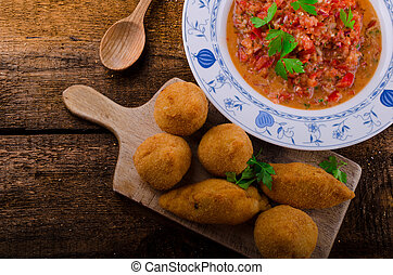Street food is popular the world over, but the Brazilians is the best. Creamy chicken filling coated in a chicken dough then breadcrumbs - fried perfect and hot tomato salsa