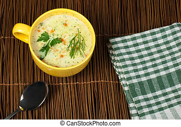 Chicken Cream Soup. Spoon and bread on the table