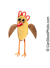 Chicken created from black bread and vegetables on white background