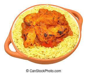 Chicken curry and pilau rice meal isolated on a white background