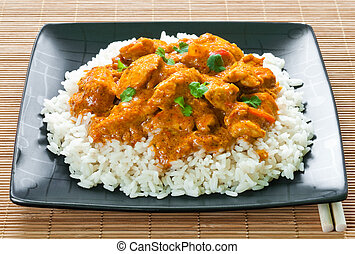 Chicken curry with rice and chopsticks on place mat