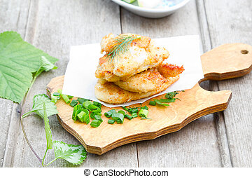 Chicken cutlet - Stack of chicken cutlet on a wooden cutting...