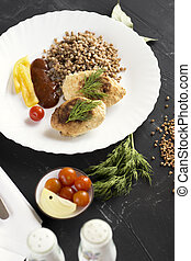 Chicken cutlets with buckwheat, herbs, ketchup and tomatoes