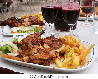 chicken dinner - chicken, french fries and sangria at an ...