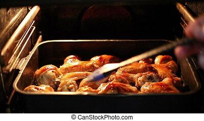 Chicken drummets deep frying in oil
