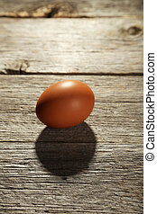 Chicken egg on grey wooden background