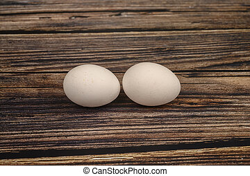 Chicken egg on wooden table background. close up