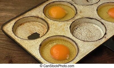 Chicken eggs in a frying pan. Rustic style.