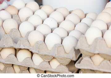 Chicken eggs in cardboard egg crate. Domestic chicken eggs close up. Organic food concept.