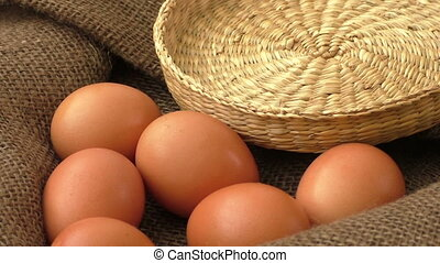 Chicken eggs on brown burlap