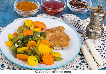 Chicken fillet grilled with vegetable mixt on wooden background