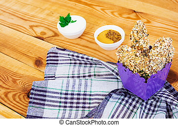 Chicken fillet in oat flakes on wooden background