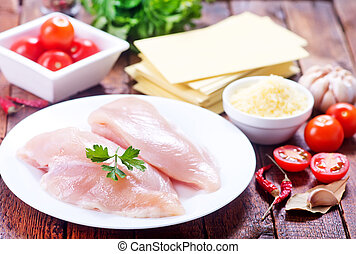 chicken fillet on plate and on a table