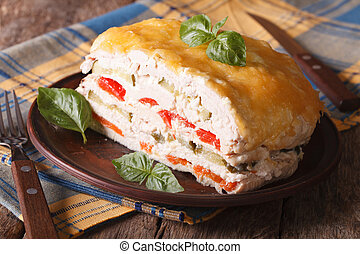 Chicken fillet stuffed with vegetables and cheese on a...