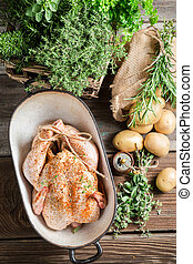 Chicken for cooking with spices and vegetables