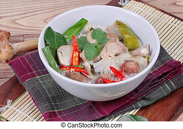 Chicken, galangal in soup.Close up