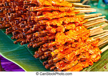 chicken grill on green banana leaves,Thailand